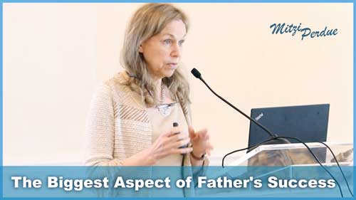 Image of Mitzi talking in front of microphone. Subtext reads 'The Biggest Aspect of Fathers Success'