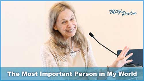 Image thumbnail showing Mitzi Smiling in front of a Microphone. Subtext reads 'The Most Important Person in My World'